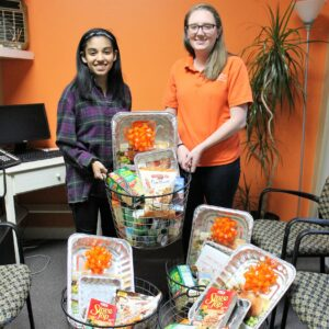Margaux and Sami with Thanksgiving baskets.
