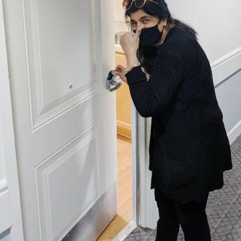 Ms. Farooqi at her apartment door.